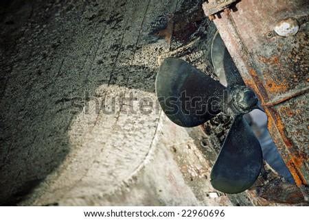 Tilt view of a propeller at shipyard - stock photo
