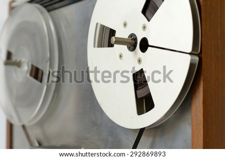 tilt view of an old reel to reel player and tape recorder  - stock photo