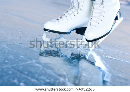 Tilted blue version, ice skates with reflection - stock photo