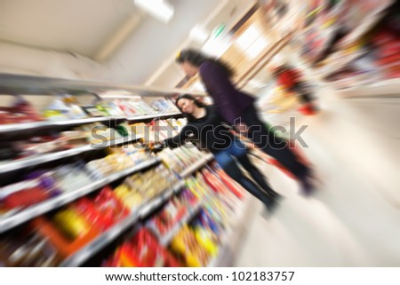 Tilted blur image of women shopping in shopping in shopping centre - stock photo