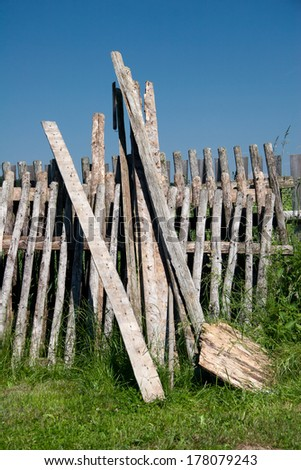 Timber battens and batten fields of an old garden fence - stock photo