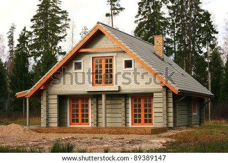 timber chalet in the woods - stock photo