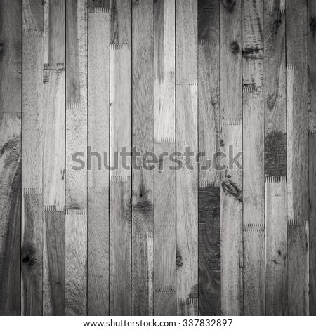 timber dark wood wall barn plank texture, black and white monochrome image used vignette retro vintage background - stock photo