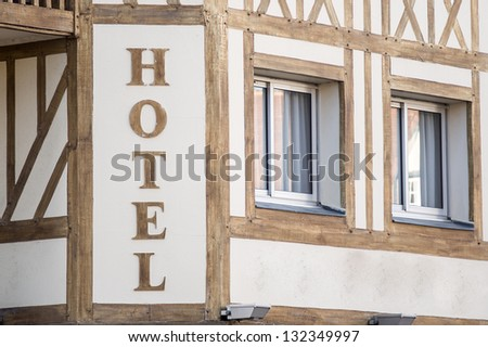 Timber frame hotel sign in Deauville, France - stock photo