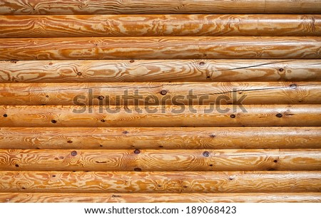 timber logs wall closeup texture pattern front view - stock photo