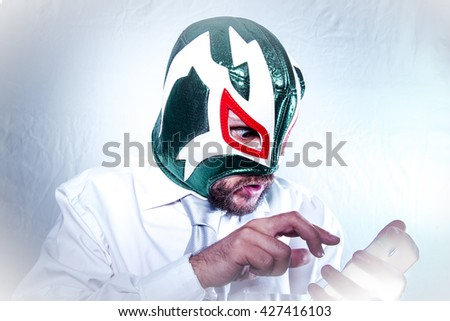 Time, angry businessman with Mexican wrestler mask, expressions of anger and rage - stock photo