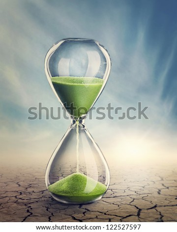 Time concept with a hourglass - stock photo