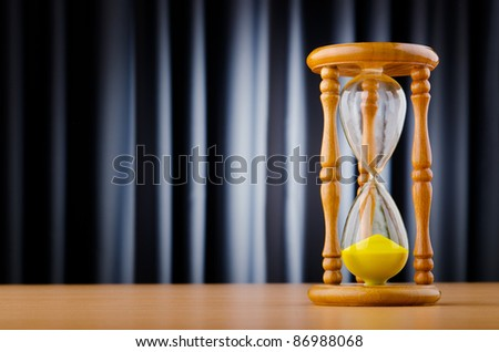 Time concept with hour glass - stock photo