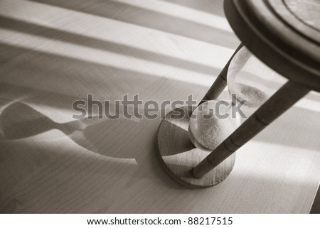 time concept with hourglass in warm balck and white - stock photo
