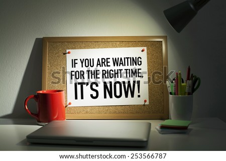 Time for action concept note on bulletin board / If you are waiting for the right time, it is now - stock photo