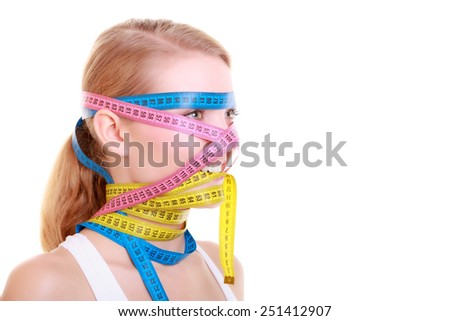 Time for diet slimming weight loss. Health care healthy lifestyle. Fit fitness woman with a lot of colorful measure tapes around her head. Obsessed girl by body. - stock photo