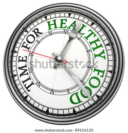 time for healthy food concept clock closeup on white background with red and black words - stock photo