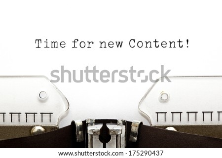 Time for new Content printed on an old typewriter. - stock photo