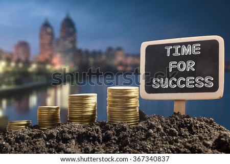 Time for success - Financial opportunity concept. Golden coins in soil Chalkboard on blurred urban background - stock photo