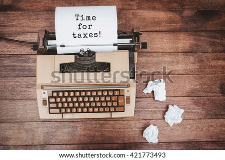 Time for taxes! message against view of an old typewriter and paper - stock photo