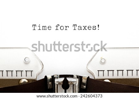 Time for Taxes printed on an old typewriter. - stock photo