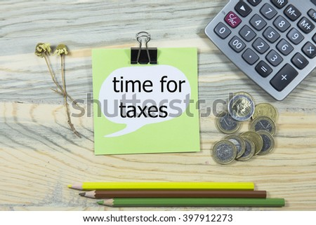 time for taxes writing in sticky note. pen,euro and calculator. business concept - stock photo