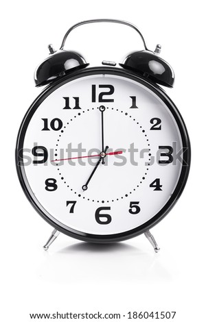 Time for work - Alarm Clock Shows Seven o`clock - isolated on white background - stock photo