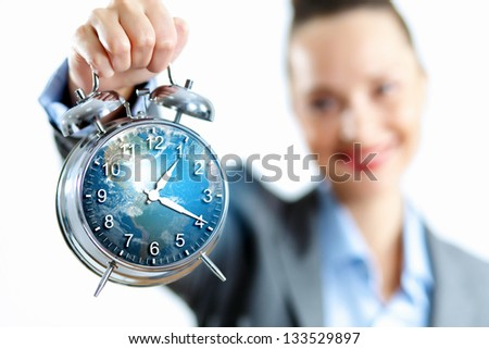 Time in business illustration with clock in hands of businesswoman. Elements of this image are furnished by NASA - stock photo