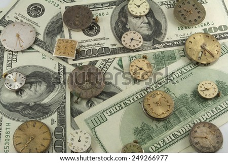 Time is money. Background of dollars and watches - stock photo