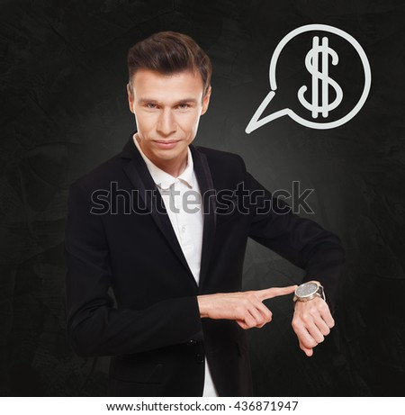 Time is money. Businessman point at his watch showing time is money concept. Man in suit with watch at black background, thinking cloud with dollar sign. Work and earn, business, finance. - stock photo
