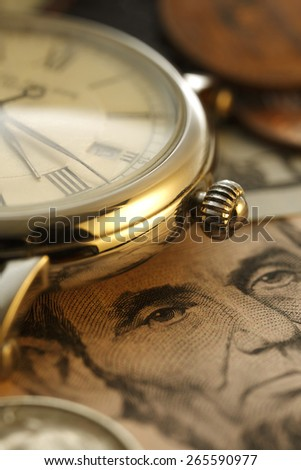 Time is money.  Clock in US dollars - stock photo