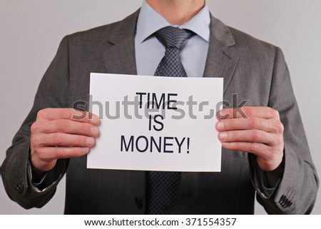 Time is money. Close up of businessman showing card.  Business, teamwork and finance concept. - stock photo