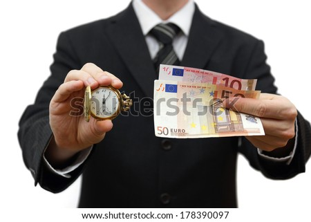 time is money concept with businessman with money and pocket watch - stock photo