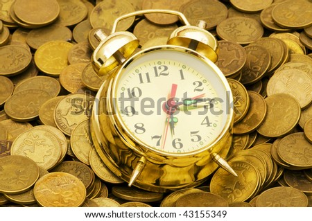 Time is money concept with clock and coins - stock photo