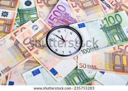 Time is money concept with euro money - stock photo