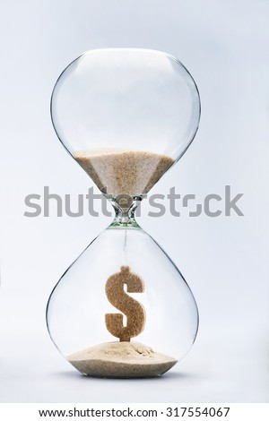 Time is money concept with falling sand taking the shape of a dollar - stock photo
