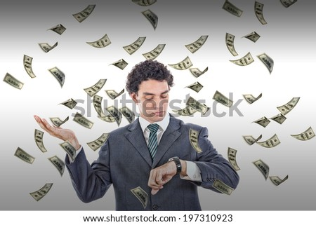 Time is money concept with man looking at watch catching falling bills - stock photo