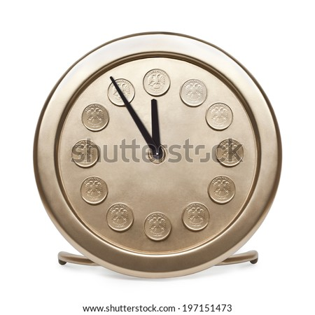 Time is money. Large gold table clock with Russian coins on the dial. - stock photo