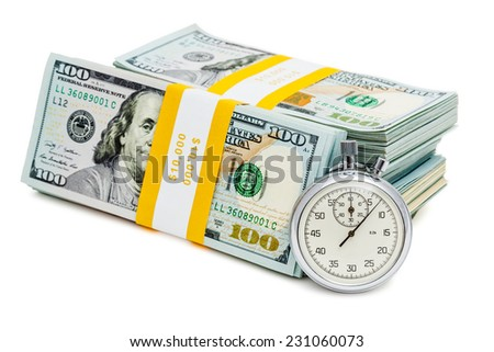 Time is money loan concept background - stopwatch and stack of new 100 US dollars 2013 edition banknotes (bills) bundles isolated on white - stock photo