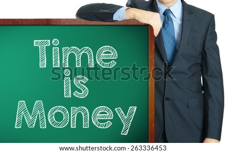 Time is money on blackboard presenting by businessman or teachaer - stock photo