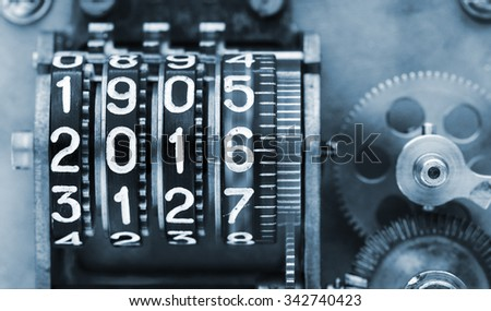 Time is running too fast. Two thousands sixteen. The old, mechanical counter, with digits. - stock photo