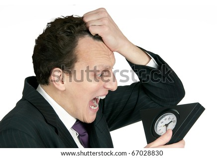 Time-management concept: business man looking at clock is shocked. Studio shot, isolated on white background - stock photo