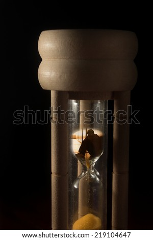 Time of hopeless,surreal sad people in hourglass. - stock photo