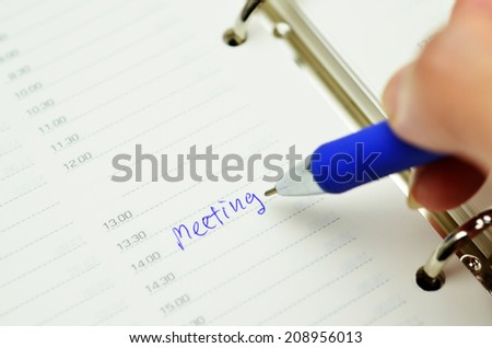 time planner with pen  - stock photo