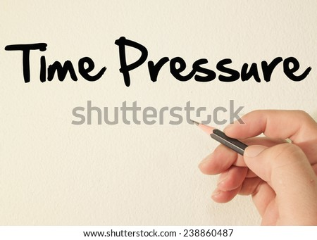 Time pressure text write on wall  - stock photo