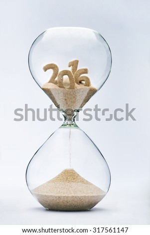 Time running out concept with hourglass falling sand from 2016 - stock photo