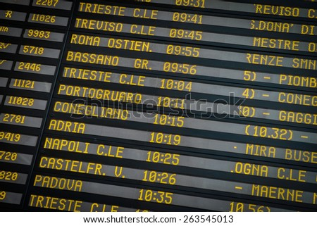 Time-table of exits and train arriving at the station of the Italian city of Venice - stock photo