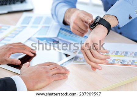 Time to be partners. Two Confident businessman sitting at the negotiating table in the office and shaking hands close-up view of hands. Business people dressed in formal wear - stock photo