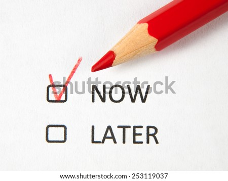 Time to choose now or later - stock photo