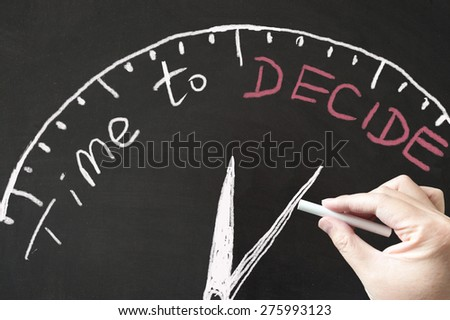Time to decide concept diagram drawn on the blackboard using chalk - stock photo