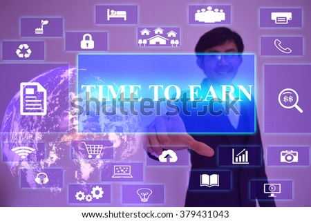 TIME TO EARN concept  presented by  businessman touching on  virtual  screen ,image element furnished by NASA - stock photo