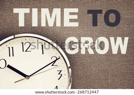 Time to Grow concept and clock face - stock photo