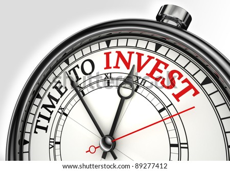 time to invest concept clock closeup on white background with red and black words - stock photo