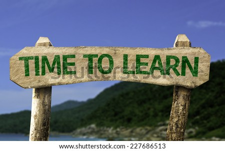 Time To Learn wooden sign with a beach on background - stock photo