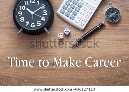 Time To Make Career written on wooden table with clock,dice,calculator pen and compass - stock photo